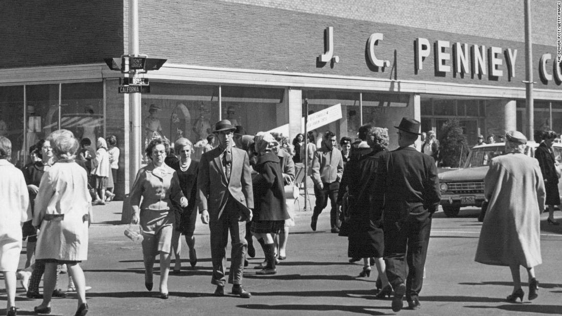 Shoppers hurry across an intersection in front of a JCPenney store in Denver in 1964.