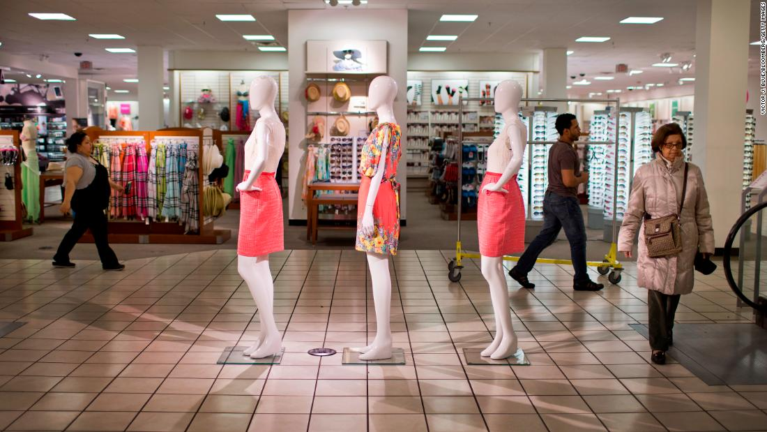 Customers walk past mannequins at a JCPenney store in New York in 2013.