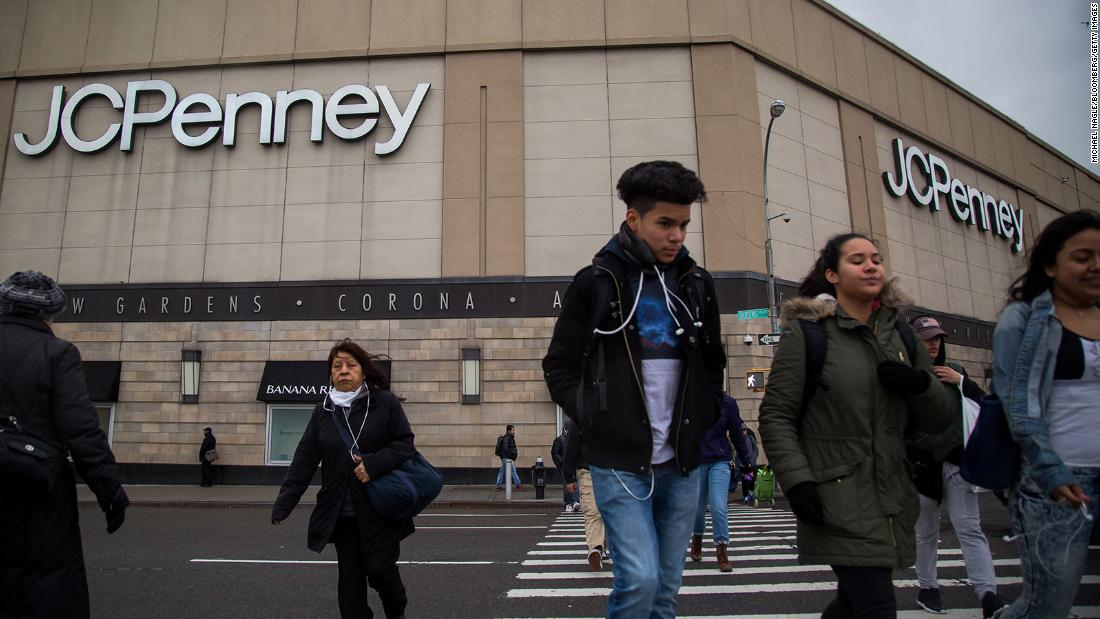 People walk past a JCPenney store at the Queens Center Mall in New York in 2016.