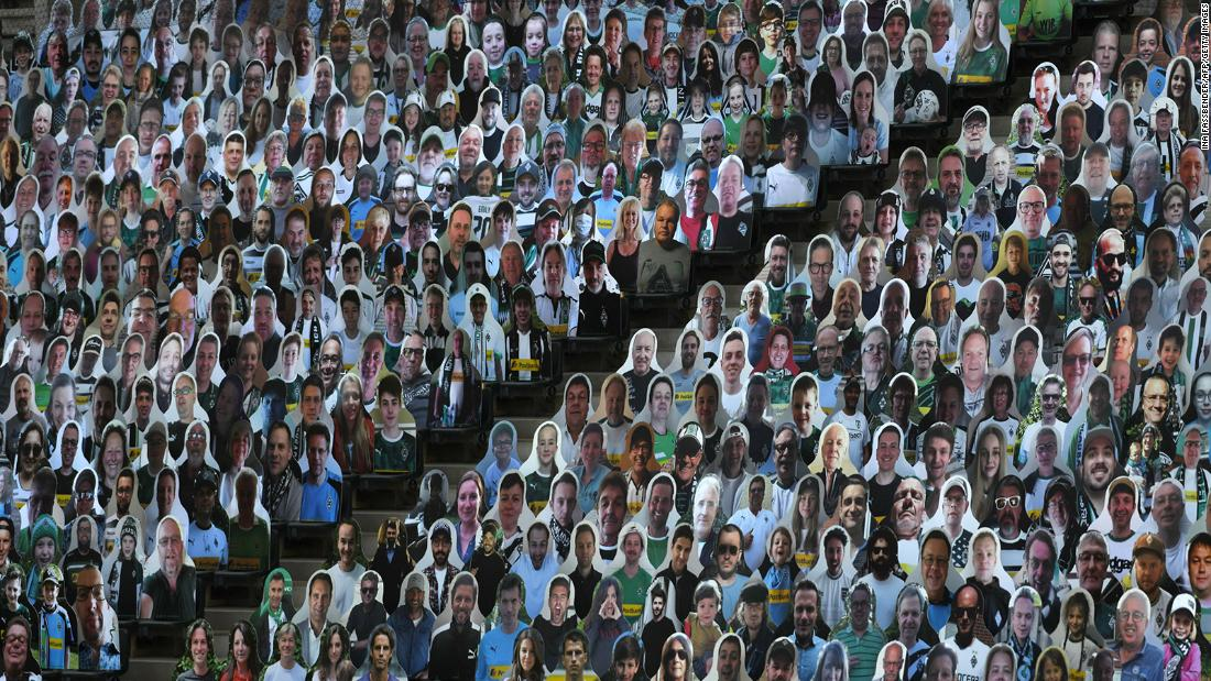 "Cardboard cutouts of soccer fans are seen at the Borussia-Park stadium in Mönchengladbach, Germany, on May 19. The Bundesliga, Germany's top pro soccer league, became <a href=""https://www.cnn.com/2020/05/16/sport/germany-bundesliga-return-football-spt-intl/index.html"" target=""_blank"">the first major European competition to return amid the coronavirus pandemic.</a>"