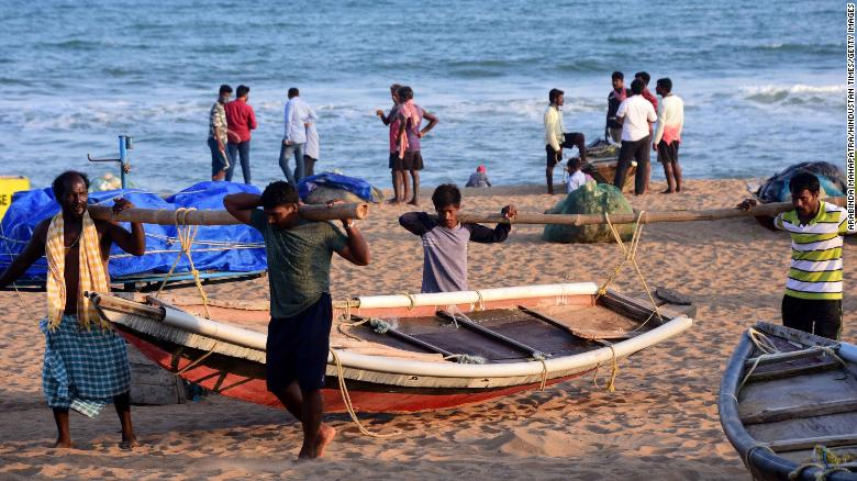 Fishermen bringing in their boats after warnings were sounded ahead of the cyclone's arrival on May 18 in Puri, India.
