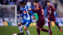 Lionel Messi tries to tackle Granero during Barcelona's La Liga clash against Espanyol in 2018.