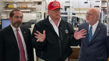 President Donald Trump speaks next to US Health and Human Service Secretary Alex Azar and CDC Director Robert Redfield  during a tour of the Centers for Disease Control and Prevention on March 6, 2020.