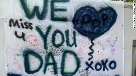 Kevin Johnson came up with the idea to spray paint a sheet with messages for his father.