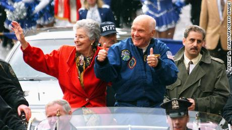Annie Glenn, seen here at a ticker-tape parade with her late husband John Glenn, died of coronavirus complications. She was 100.