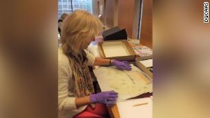 Professor Joan Taylor examining the Dead Sea Scrolls fragments.