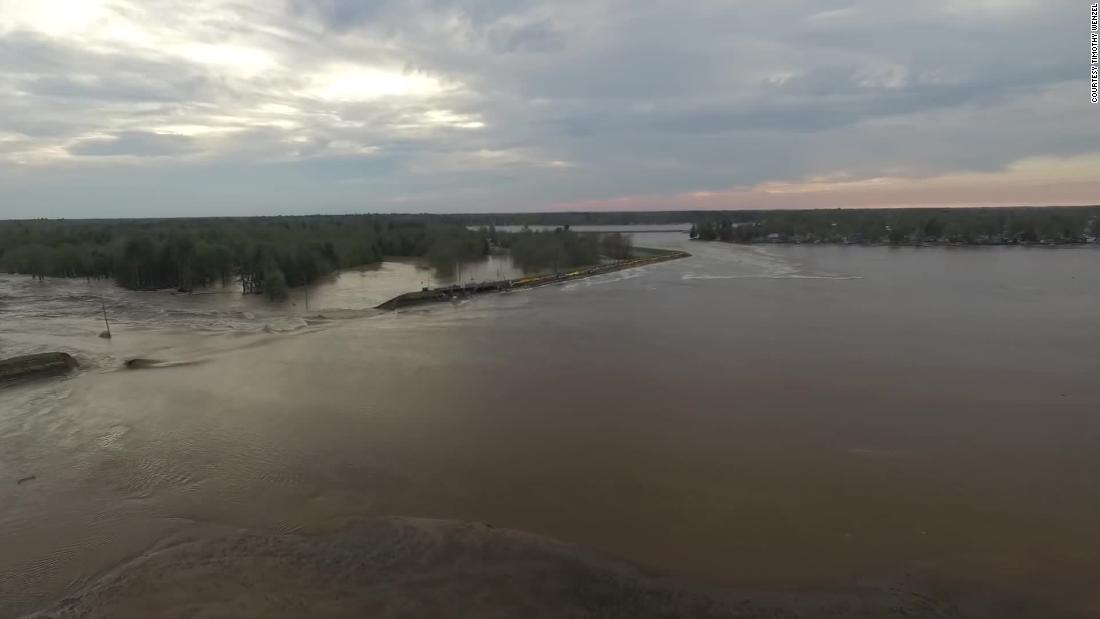 The Tittabawassee River breaches the Edenville Dam on Tuesday.