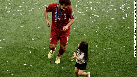 Salah celebrates with his daughter Makka after his side won during the UEFA Champions League Final.