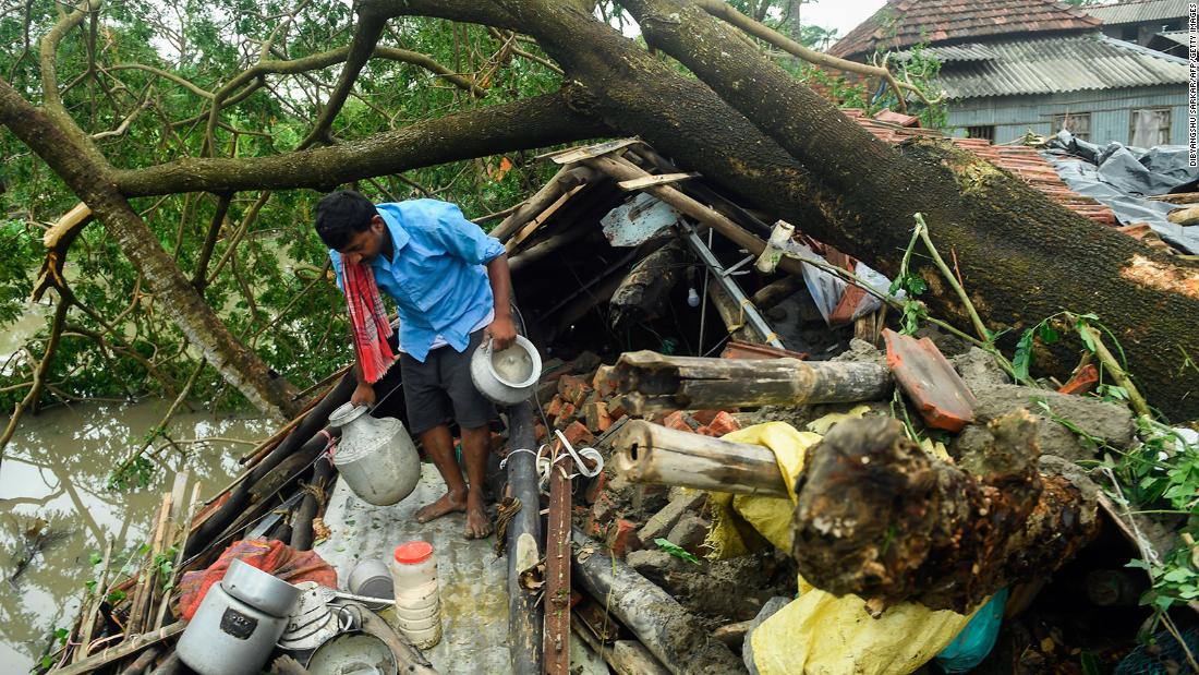 A man salvages items from his house damaged by cyclone Amphan in Midnapore, West Bengal, on May 21, 2020. - The strongest cyclone in decades slammed into Bangladesh and eastern India on May 20, sending water surging inland and leaving a trail of destruction as the death toll rose to at least nine. (Photo by Dibyangshu SARKAR / AFP) (Photo by DIBYANGSHU SARKAR/AFP via Getty Images)