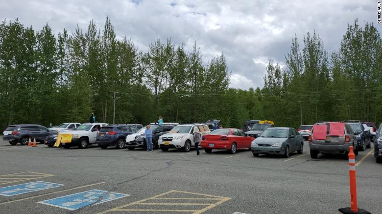 More than 80 cars showed up to protest a previous decision by an Alaska school board to remove five books off reading lists.