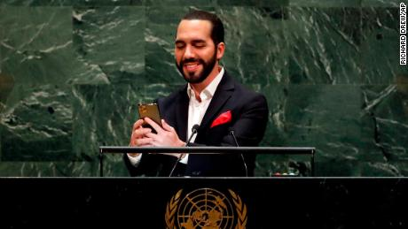 El Salvador's President Nayib Bukele takes a selfie portrait during his addresses to the 74th session of the United Nations General Assembly, Thursday, Sept. 26, 2019. (AP Photo/Richard Drew)