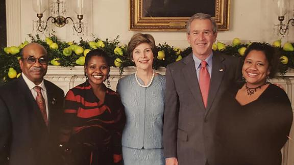 Former White House butler Wilson Roosevelt Jerman with then-President George W. Bush and first lady Laura Bush.
