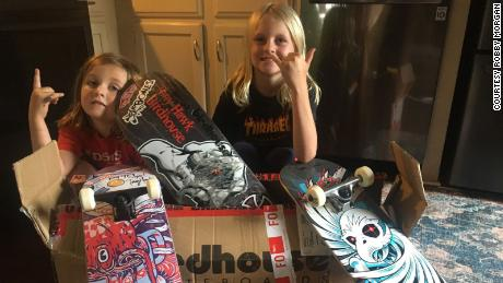 Cooper Morgan (left) and Tucker Morgan (right) with the package sent to them by pro skater Tony Hawk.