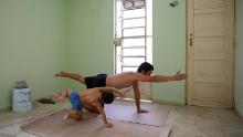Photographer Bénédicte Desrus and his son Thiago  do yoga together during the pandemic in Mérida, Yucatán, Mexico.