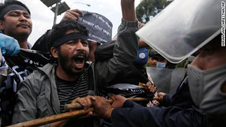 Nepalese protesters stage a demonstration on Saturday, May 9 during lockdown in Kathmandu, against a new link road to Lipulekh, a disputed territory between India and Nepal.