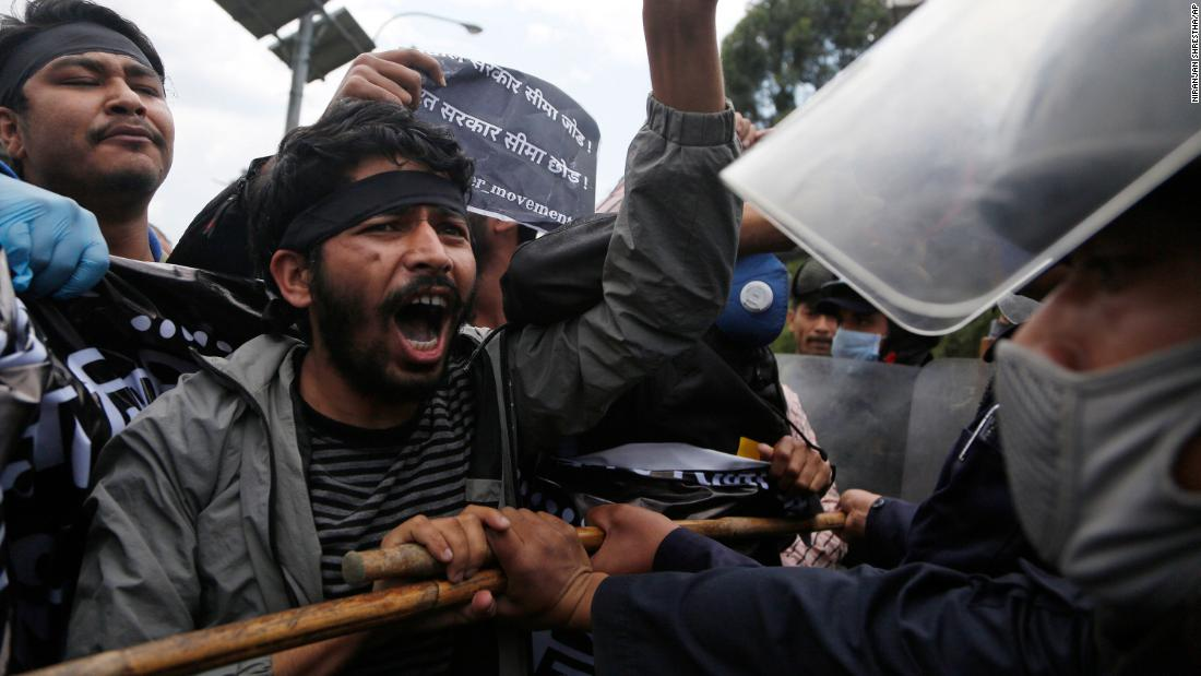Nepalese protesters clashed with police officers during a demonstration during lockdown in Kathmandu, held against the Indian government for building a link road to Lipulekh, a disputed territory between India and Nepal.