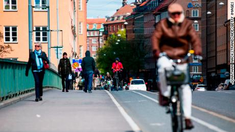 Pedestrians and cyclists cross a bridge in the heart of Stockholm on May 11.