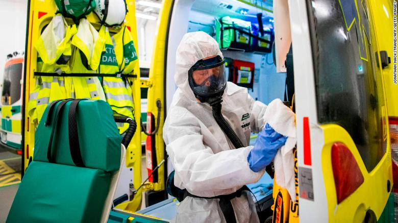 A healthcare worker cleans and disinfects an ambulance after dropping a patient at the Intensive Care Unit (ICU) at Danderyd Hospital near Stockholm on May 13.