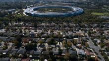 Apple Park in Cupertino cost the iPhone maker an estimated $5 billion to build. It features massive, four-story-tall windows that slide open like subway doors. The entire building rests on hundreds of steel saucers that keep it stable during earthquakes.