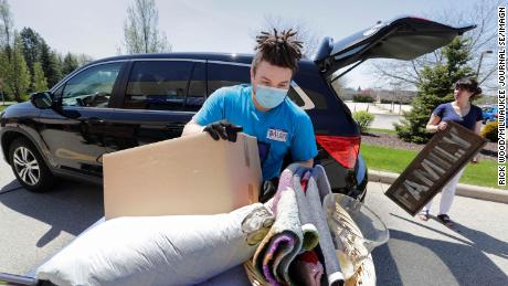 An employee unloads donations on May 15 at a Brookfield, Wisconsin, Goodwill location.