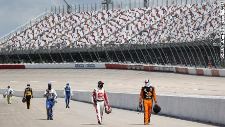 With no fans in attendance, drivers walk down the grid during the NASCAR Cup Series The Real Heroes 400 at Darlington Raceway on May 17, 2020 in Darlington, South Carolina.