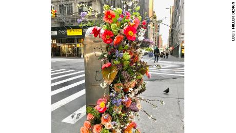 A New York phone booths erupting with flowers in one of Miller's flower flashes on March 12.