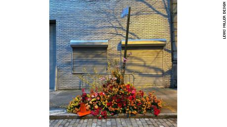 "Miller's flower flash from March 31 that adorned a ""no parking"" sign on 22 Wooster Street."