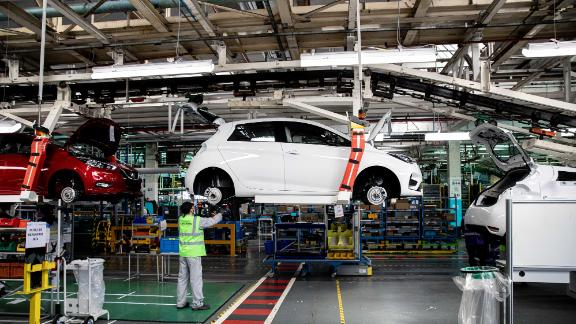 An employee secures a rear axle fitting on a Renault Zoe electric automobile at the Renault SA factory in Flins, France, on Wednesday, May 6, 2020. European car sales were almost wiped out in April after governments around the continent closed auto dealerships and other businesses to slow the spread of the coronavirus. Photographer: Christophe Morin/Bloomberg via Getty Images