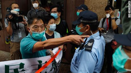 "Police officers stop members of the Democratic Party moving forwards the Chinese central government's liaison office during a protest in Hong Kong, Friday, May 22, 2020. Hong Kong's pro-democracy lawmakers have sharply criticized China's move to take over long-stalled efforts to enact national security legislation in the semi-autonomous territory. They say it goes against the ""one country, two systems"" framework that promises the city freedoms not found on the mainland. (AP Photo/Kin Cheung)"