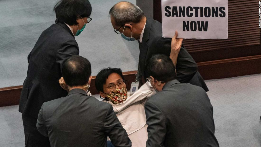 Pro-democracy lawmaker Eddie Chu Hoi-dick is removed by security during a scuffle with pro-Beijing lawmakers at the Legislative Council in Hong Kong on May 22.