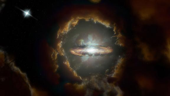 This is an artist's impression of the Wolfe Disk, a massive rotating disk galaxy in the early universe.