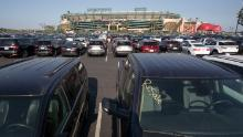 Thousands of rental cars are stored at Angel Stadium of Anaheim, a sign of the plunge in demand for rental cars.