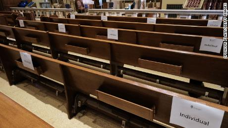 Church pews are marked with signs to allow congregants to practice social distancing.