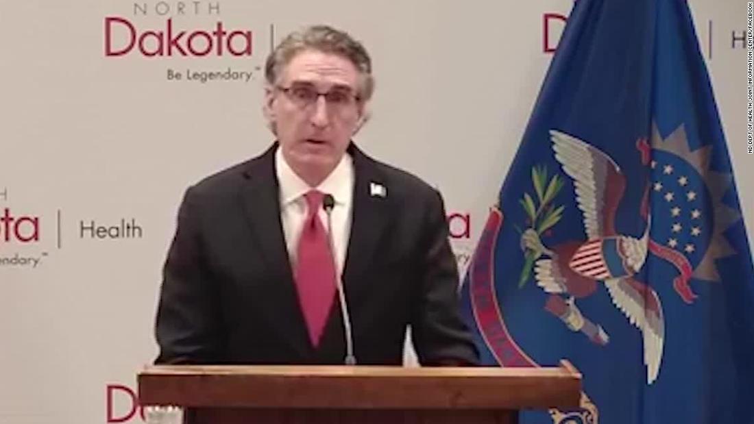 North Dakota governor makes emotional plea to avoid divide over face masks