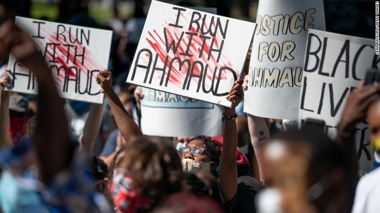 Demonstrators protest the shooting death of Ahmaud Arbery at the Glynn County Courthouse on May 8, 2020 in Brunswick, Georgia.