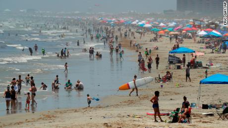 People gather on the beach for the Memorial Day weekend in Port Aransas, Texas, on Saturday.