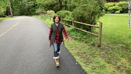 "Carol Weston, seen here on one of her walks, writes ""I count steps and blessings. I keep my chin up. Yet it's hard not to know when I'll see my daughters again."""