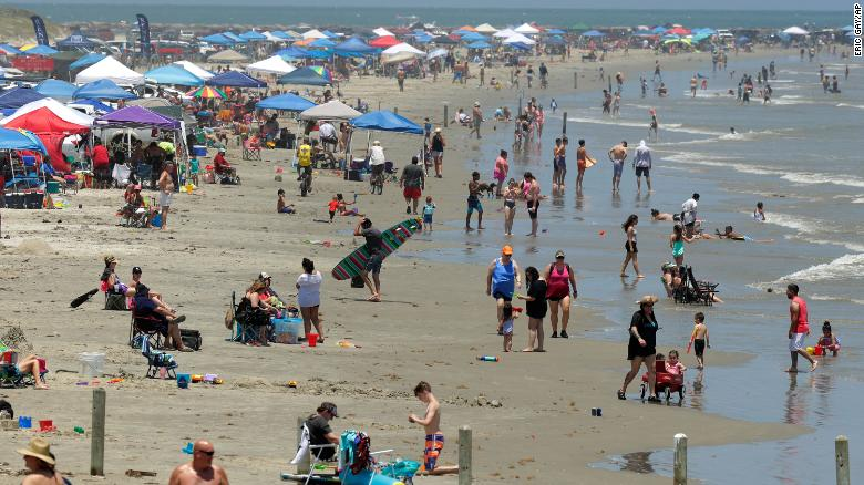 Covid-19 cases surge in some states as Americans celebrate Memorial Day weekend