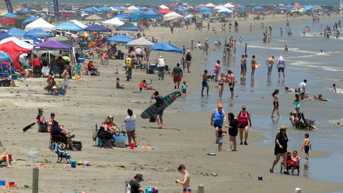 As Americans flock to beaches and parks, some states see surges in new coronavirus cases