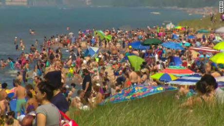 Photos show plenty of people flocked to beaches, but not a lot of social distancing or masks