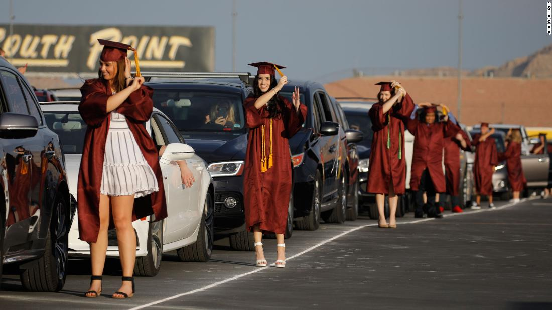 High school graduates turn their tassels during a drive-thru graduation ceremony at the Las Vegas Motor Speedway on May 22.