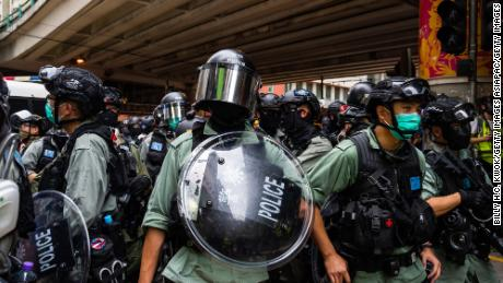 Riot police stand guard during an anti-government rally on May 24, 2020 in Hong Kong.