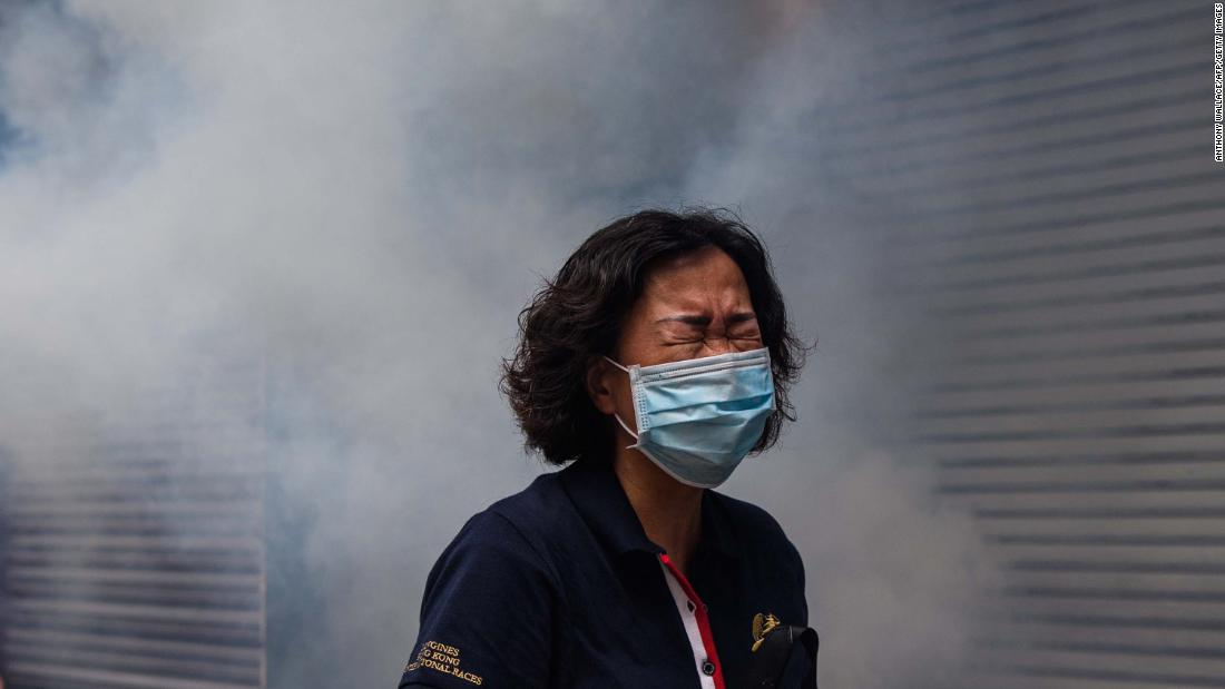 A woman reacts to tear gas on May 24.