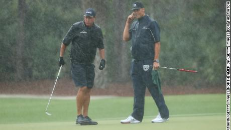 Mickelson and Brady on the 13th green.