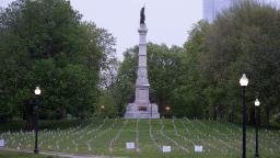 A thousand flags honor Massachusetts military heroes in a scaled-back Memorial Day observance