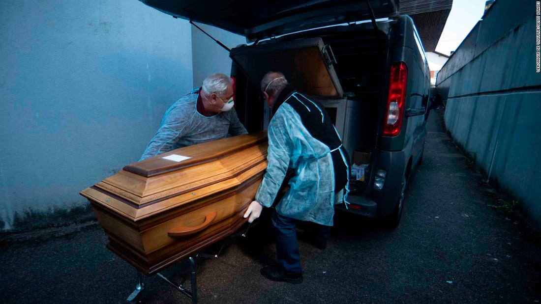 BANTZENHEIM, FRANCE- 5 APRIL 2020: (EDITORIAL USE ONLY) Bouli and Alain, undertakers, arrive at nursing home to retrieve two bodies of elderly people who died overnight from coronavirus on April 5, 2020 in Bantzenheim, France. By the beginning of April, France had more than 50,000 confirmed cases of COVID-19, with more than 4,000 related deaths. The country's Grand Est region, which includes the town of Mulhouse, has been particularly badly affected. The region became one of Europe's largest clusters of coronavirus cases after infected people attended a 2,500-person prayer meeting at a Mulhouse megachurch in February, well before the country imposed quarantine measures. (Photo by Veronique de Viguerie/Getty Images)