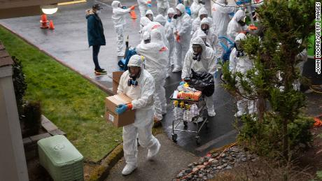 A cleaning crew enters the Life Care Center on the outskirts of Seattle, Washington on March 12.