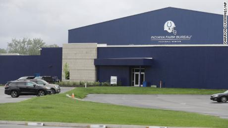 A parking lot is nearly empty in front of the Indianapolis Colts training facility on May 19 in Indianapolis. Coaching staffs and all players except those undergoing injury rehabilitation are barred from the facilities in the first phase of the league's plan.