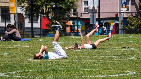 People exercise in circles drawn to promote social distancing at Dolores Park in San Francisco, California, U.S., on Thursday, May 21, 2020. San Francisco Mayor London Breed threatened to close Dolores Park if crowding continues. Photographer: David Paul Morris/Bloomberg via Getty Images