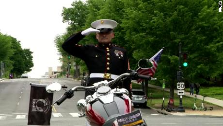 Retired US Marine Corps Staff Sgt. Tim Chambers saluted for 24 hours on a median in Washington on May 24 to raise awareness about veteran suicide.